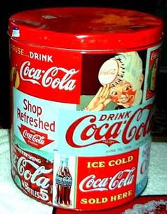 vintage coke signs | Tin cannister! This great collectible covered with dozens of old coke ...