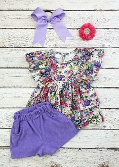 Double angel sleeve tunic covered in brilliant wildflowers, with a pearl button keyhole closure in the back, and paired with soft, elastic waist lavender corduroy shorts with pockets and a faux button tab. Any accessories shown are not included. #corduroy #wildflowers #floral #boutiqueforgirls #sunshine #cutekidsclothes Cute Girl Outfits, Cute Outfits For Kids, Trendy Outfits, Cute Girls, Corduroy Shorts, Angel Sleeve, Floral Tunic, Shorts With Pockets, Wildflowers