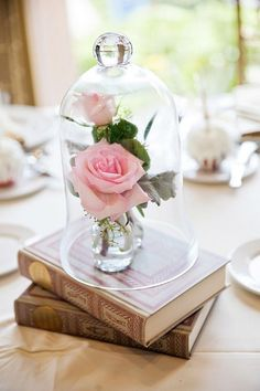 Beauty and the Beast inspired rose centerpiece decor / http://www.himisspuff.com/glass-cloche-bell-jar-wedding-ideas/2/