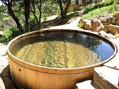 12'x10' oval custom cedar wooden hot tub built and installed by Gordon and Grant. http://www.gordonandgrant.com/