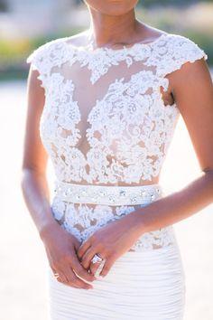 Sheer lace short sleeve wedding dress: http://www.stylemepretty.com/2016/02/23/trend-short-sleeve-wedding-dresses/