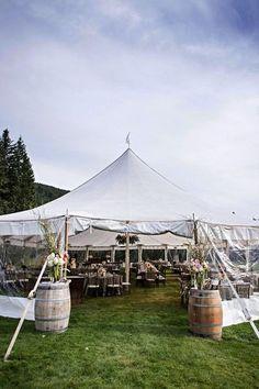 Outdoor wedding reception idea - sailcloth tent with wine barrels + flower arrangements {Lauren Brown Photography}