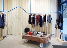 """Max Lamb surrounds Opening Ceremony boutique with """"lustrous"""" latex rubber curtains."""
