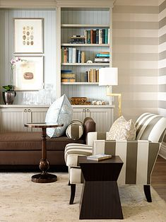 Horizontal stripes in a tone on tone, painting the cabinetry the same as the stripe