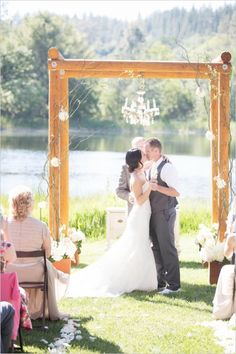 A chandelier and a rustic arbor are a perfect frame for a lake or pond side ceremony.