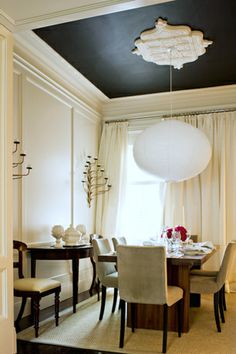 I love the black ceiling with that molding thing (what do you call that?) around the light fixture.