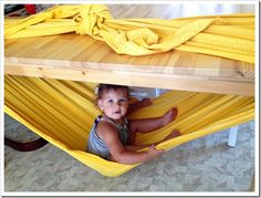 // How to Make a Woven Wrap Hammock. This would be great for a rainy day. Or make a table fort with a hammock inside! Be Mom of the Year according to your kids.