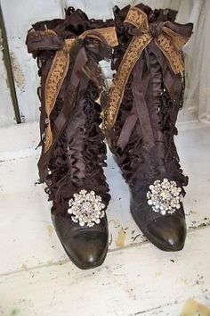 Black Victorian boots embellished with dark brown ruffles bows and more from Anita Spero Design