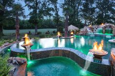 Bossier City Pool Design, Shreveport Pool Construction - natural-grotto-boulder-waterfall-tanning-ledge-stone-Deck-stone-planter-turtle-bay-pebble-sheen-grand-effects-fire-bowl-multi-level-LED-lights-infinity-edge