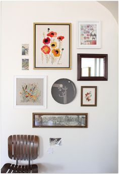 sweet wall arrangement.. the round artwork in the middle is a vintage hat box lid!