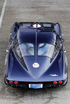 1963 Corvette Stingray 'split-window'. Note that the door's opening is cut into the roof for ease of getting in and out. Beautiful car. McC