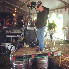 When filming a documentary at a festival full kegs of beer make for a solid platform. Shot of camera guy from Slowboat Films shooting Hard Soil, The Muddy Roots of American Music at Muddy Roots Europe Festival 2013 in Belgium.  www.muddyrootsmusic.com Beer Keg, How To Make Beer, Documentary, Belgium, Roots, Films, Guy, Platform, Home Appliances