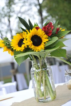 Mason Jar and Sunflowers - centrepiece for  fall outdoor wedding... Wedding ideas for brides, grooms, parents & planners ... https://itunes.apple.com/us/app/the-gold-wedding-planner/id498112599?ls=1=8 … plus how to organise an entire wedding, without overspending ♥ The Gold Wedding Planner iPhone App ♥ http://pinterest.com/groomsandbrides/boards/