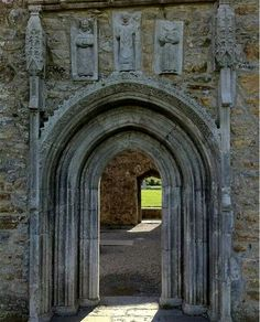 St. Dominic, St. Patrick, St. Francis carvings over door to cathedral in Clonmacnoise, Ireland
