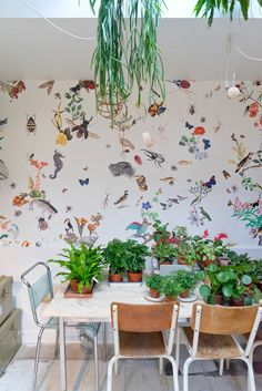 Plants + animal decals in a dining room. I especially love the animal decals. // JOELIX.com | Mama Petula in Paris