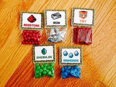 """Minecraft goodie bags. Candy + Wilton 3""""x4"""" clear treat bags + tented food cards, available at http://catchmyparty.com/blog/free-minecraft-party-printables-from-printabelle"""