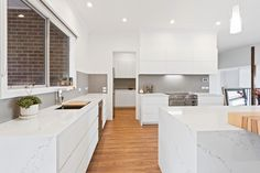 The extensive use of sleek white cabinets and benchtops create a bright and open kitchen space leading into a butler's pantry. Kitchen Room Design, Open Kitchen, Custom Cabinets, Cabinet Design, White Cabinets, White Marble, Pantry, Custom Design, New Homes