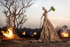 fabrice monteiro shows senegal's pollution with site-sourced garbage garments