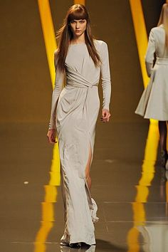This dress is ridiculously elegant and the slit just adds that extra dramatic effect to the outfit