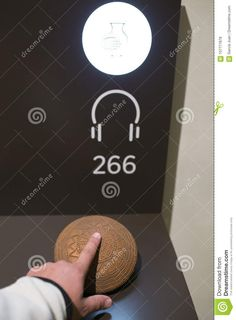 Tactile display. Blind visitor touching a neolithic pottery replica at National Archeological Museum of Madrid