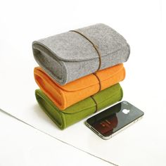 Love this gorgeous felt case for your iPhone and all it's accessories.