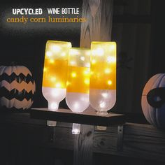 #Upcycled Wine Bottle Candy Corn luminaries for #Halloween #repurpose #recycledCrafts