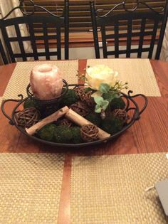 Got this wrought iron tray for Christmas and put a candle, an artificial flower and some natural looking filler from home goods to create this nice centerpiece