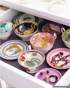 Decorative bowls, plates, and tea cups make this jewelry drawer colorful and functional