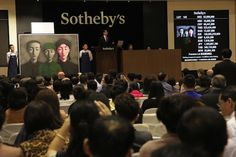 The record-breaking sale of Zhang Xiaogang's Bloodline: Big Family No. 3 at Sotheby's Hong Kong on April 5. (Sotheby's)