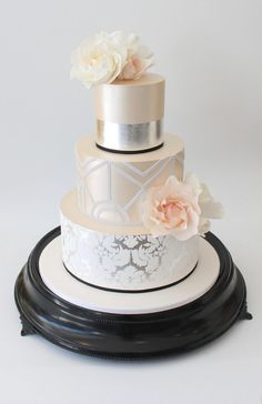 Love this bottom layer - we want this as our bottom layer please, and we like the foil stripe on our top layer too! We would like a plain middle cake with a teal ribbon to match our colours