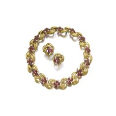 Gold, ruby and diamond demi-parure, monture Cartier, 1960s