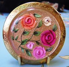 vintage powder compact by damselfly58- settling in but using wi fi. very slo, via Flickr