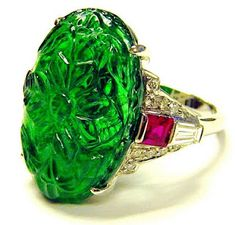 Carved emerald ring with rubies and diamond in platinum
