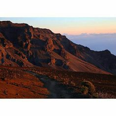 Photo by @tylermetcalfe // Beautiful light this morning in the Haleakalā volcano. I was up at 2am in order to catch this one, but ended up making it down into the crater about two hours before sunrise and spent some quality time with the stars. It was dark and cold, and the wind was fierce, but moments like these are gifts for those who are accepting of the elements. Haleakalā National Park, Maui, Hawaii. #findyourpark