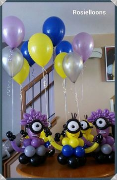 Super idea: little Minion sculptures as bases for the balloon bouquets.