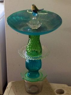 recycled glass birdbath, diy home crafts, repurposing upcycling Birdbath from old plates and vases GE Silvone II to hold it together