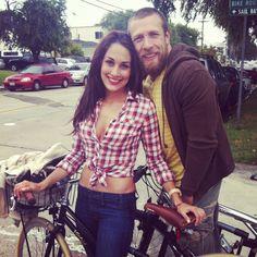 brie bella and daniel bryan taking a bike ride
