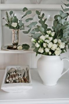 White roses, eucalyptus, berries, fir