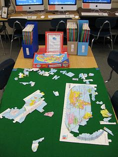 Library Puzzle Center: Students synergize across classes to complete puzzle.