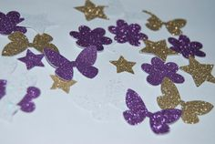 """$3 - This fairy themed sparkly confetti is an adorable addition to your party. The gold, purple and white glitter butterflies, stars and flowers add a perfect """"pop"""" to your table.  Looking for other Woodland Fairy Themed Party Decorations? See all that we offer for this party theme at http://etsy.me/1dz2yQz"""