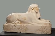 The reconstructed sections of this sphinx have been cast from an almost identical, but more complete companion piece now in Cairo. The two small limestone sphinxes may have been on either side of the entrance to the upper terrace of Hatshepsut's mortuary temple at Deir el-Bahri