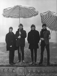 The Beatles and striped umbrellas