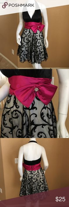 B. Darling Halter Dress! B. Darlin Formal Halter Dress! Pink Bow across front with a rhinestone gem, slight padding, size 7/8! In excellent condition only worn once! Perfect for any formal occasion or school dance! B. Darlin Dresses Midi