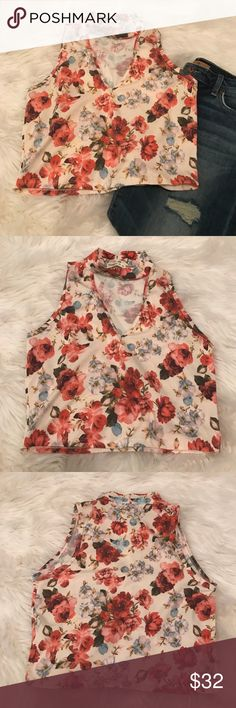 Ginger G Floral Crop Top Ginger G Floral Crop Top.  So girly yet sexy.  Deep V Neck and choker neck.  Goes great with denim or some high waist pants.   Ginger G Tops Crop Tops