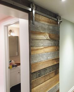 Barn board barn door on stainless steel barn door hardware for laundry and bathr… Barn board barn door on stainless steel barn door hardware for laundry and bathroom entry in a basement Reno. Bathroom Barn Door, Diy Barn Door, Pole Barn House Plans, Pole Barn Homes, Sliding Barn Door Hardware, Sliding Doors, Sliding Wall, Door Hinges, Barnyard Door