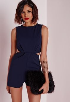 Haven't you heard? Navy is the new black, so grab this chic little playsuit in a cool navy hue. Featuring cut out waist detail and back zip fastening, pair this beaut with barely there heels and a leather jacket for an edgier look.  Approx...