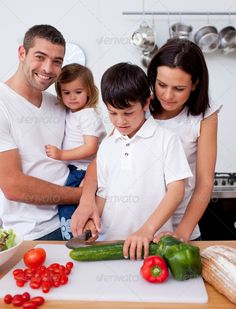 Cute son preparing food with his family ...  20s, Mealtime, adorable, beautiful, boy, bread, brother, caucasian, cheerful, child, childhood, cook, cooked, cooking, cucumber, cuisine, cut, cute, daughter, dinner, domestic, eating, family, father, female, food, girl, handsome, happiness, happy, health, healthy, home, kitchen, lifestyle, little, lunch, male, man, meal, mother, offspring, parenthood, peppers, preparation, preparing, salad, sibling, woman, young adult