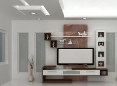 Browse our gallery of modern TV wall units and tips for how to integrate the modern TV wall unit designs for living room and modern TV stands in the living room interior, modern TV units Lcd Unit Design, Modern Tv Unit Designs, Lcd Panel Design, Modern Tv Wall Units, Wall Unit Designs, Tv Wall Design, Tv Unit Decor, Tv Wall Decor, Living Room Tv Cabinet Designs
