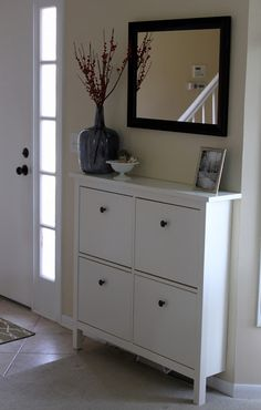 HEMNES shoe cabinet from IKEA with mirror over it instead of a normal entryway table.. takes up a lot less space!
