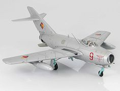 Hobbymaster 1:72 MIG 15 Diecast Model Airplane - HA2407 MIG 15 bis (DDR Air Force NVA 1959) Diecast Model Airplane. It is made by Hobbymaster and is 1:72 scale (approx. 14cm / 5.5in wingspan).  General Background  The MiG-15 (NATO name Fagot) was designed from information and technology gathered from captured WWII Germans. The main features of the Mig-15 were its simplicity and swept wings. The MiG-15bis was an improved single-seat fighter with better cannon, fuel capacity, avionics and a…